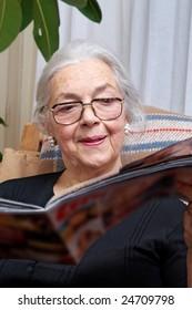 Nice grandmother read magazine