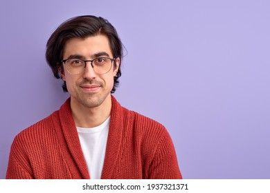 nice guy in modern spectacles posing looking at camera
