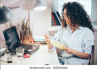 nice happy student wearing casual clothers making summaries from the Net, studing with computer. online studing. long-distance learning