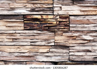 Nice house wall made from lot of various wooden slices