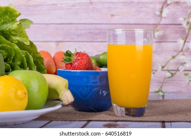 Nice image of a healthy fruit and vegetable juice, with lettuce, apples and oranges.