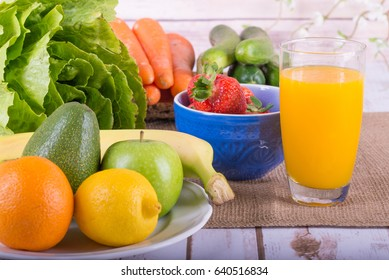Nice image of a healthy fruit and vegetable juice with carrots and other fruits and vegetables