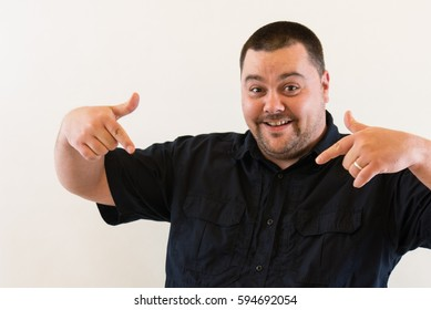 Nice Image of Middle Aged Man Pointing Down