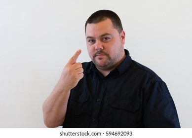 Nice Image of Middle Aged Man holding one finger up.