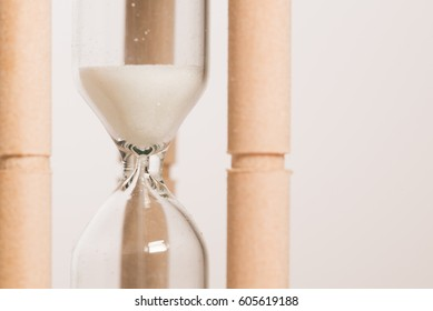 Nice image of an old style sand timer on a white background.