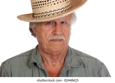A nice image of a older man wearing a cowboy or straw hat.