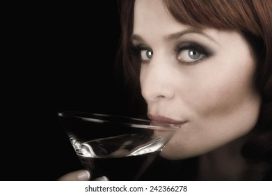 Nice image of a Woman sipping a martini on Black