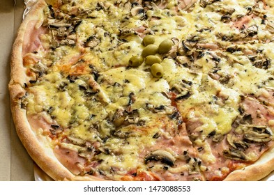 nice juicy pizza with mushrooms and cheese ( Selective focus and smail depth of field)