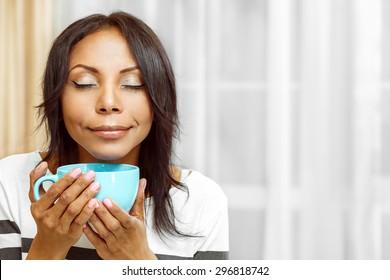 Nice lady enjoying coffee in the morning