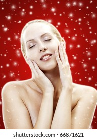 Nice lady with ideal skin. Female face - skincare as present on christmas. Spa salon, clean, cosmetics. White snowflakes on red background