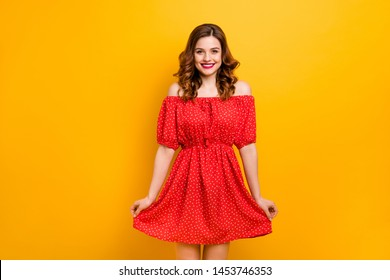 Nice lady showing new outfit ready for birthday party wear off-shoulders dress isolated yellow background