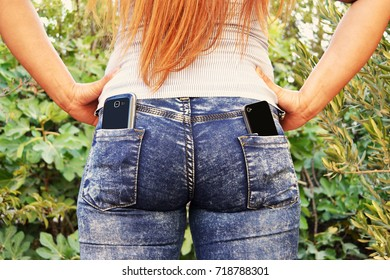 A nice lady with two smart phones in her rear pockets