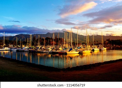 Nice landscape at the harbor of Haleiwa town and beautiful mountain background and reflection of water at golden hour in the Northshore of Oahu island, Hawaii USA