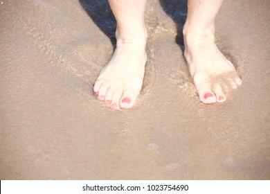 nice legs in water, nice pedicure red nail sand beach