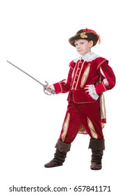 Nice little boy posing in red musketeer suit with sword. Isolated on white