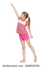 A nice little girl is performing gymnastic exercises. Concept of a healthy lifestyle, sport and fitness. Isolated on white background.