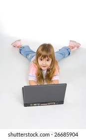 Nice little girl playing with laptop