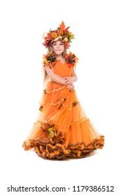 Nice little girl wearing orange autumn dress. Isolated on white