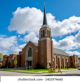Nice looking church building in downtown Holland Michigan. The architecture looks cool with the puffy clouds in the background.