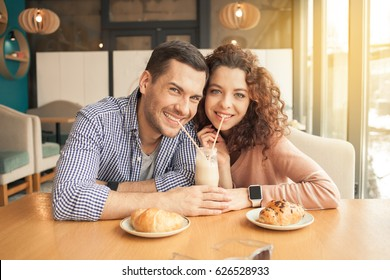 Nice looking couple in cafe