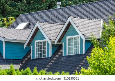 Nice looking window at the roof of the house.