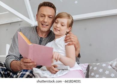 Nice loving man putting his child to sleep