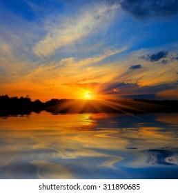 Nice majestic sunset over lake