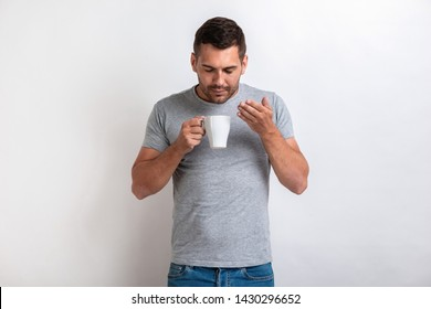 Nice man stands with cup of morning tea or coffee and smells of aroma.- Image