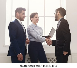 Nice to meet you. Business people handshake at first meeting, cheerful partners greeting each other, copy space