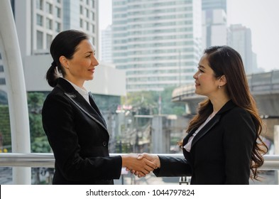 Nice to meet you. Deal. two business woman handshake after finishing up a business meeting in the modern city, congratulation, success, meeting, partner, teamwork, community and connection concept