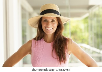nice middle age lady with long hair and wearing a hat