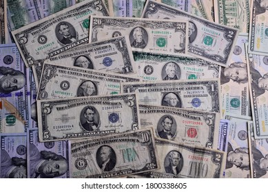A nice mixture of old United States of America money. Use as backdrop or background in horizonal layout. Many of the old numismatic notes have printing or cutting errors. Blue Green  Red Seal Notes.