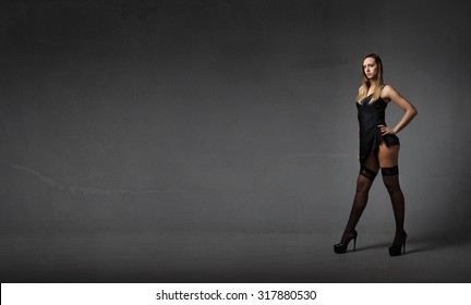 nice model posing , dark and textured background