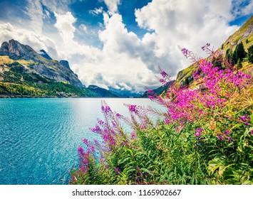 Nice morning view of Fedaia lake. Attractive summer scene of Dolomiti Alps, Gran Poz location, Trentino-Alto Adige/Sudtirol region, Italy, Europe. Beauty of nature concept background.