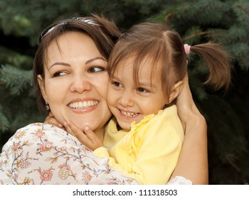 Nice mother and daughter went to walk in the forest