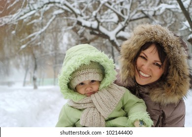 Nice mother and girl walking on the street