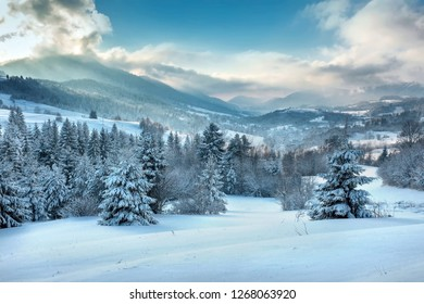 Nice mountains view in snowy sunny day under blue sky with sun light at winter time.