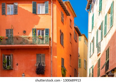 Nice, narrow street in the Vieux Nice, ancient buildings, typical facades in the old town, French Riviera