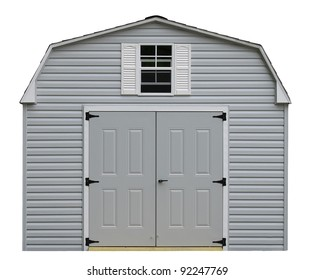 A nice new gray storage shed isolated on white with room for your text.