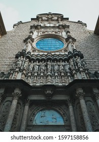 Nice old building with rock sculptures, remodeled monastery of Montserrat, Spain, Catalonia