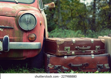 Nice old car and suitcase in with retro effect