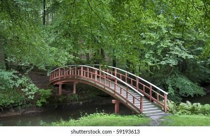 Nice old  Danish wooden bridge in park at summertime.