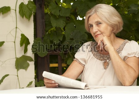 73c5b0d7 Nice Older Woman Sitting Table Home Stock Photo (Edit Now) 136681955 ...