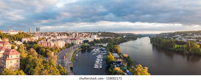 A nice panoramic view to the Prague and Vltava river during sunset at a stormy day with a cloudy sky.