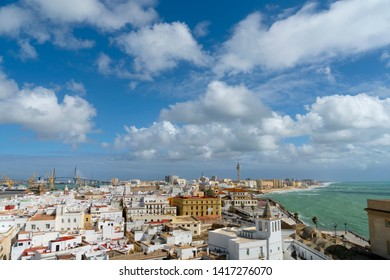 Nice panoramic view of the whole city from the cathedral's bell tower of Poniente - city rooftops, part of harbour,  La Pepa Bridge and azure waters of the Ocean. Cadiz, Andalusia, Spain, Europa.