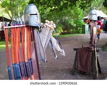 Nice picture of bows, a quiver with arrows, helmets and historic clothing exhibited during Gotland Medieval Week, in the town of Visby, Sweden
