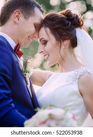 nice portrait of beautiful and young groom and bride outdoors