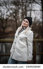 Nice portrait of blonde woman while winter walk out of town