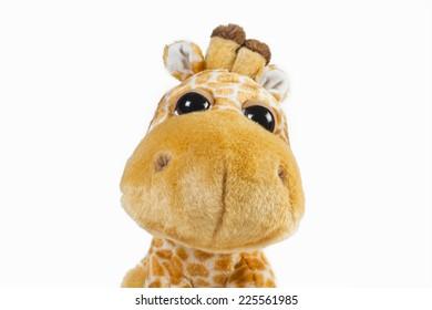 Nice portrait of a giraffe plush smiling.