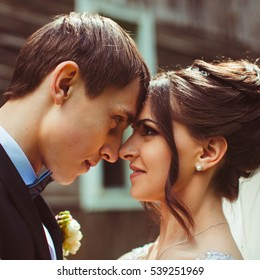 nice portrait of handsome and young groom and his beautiful bride